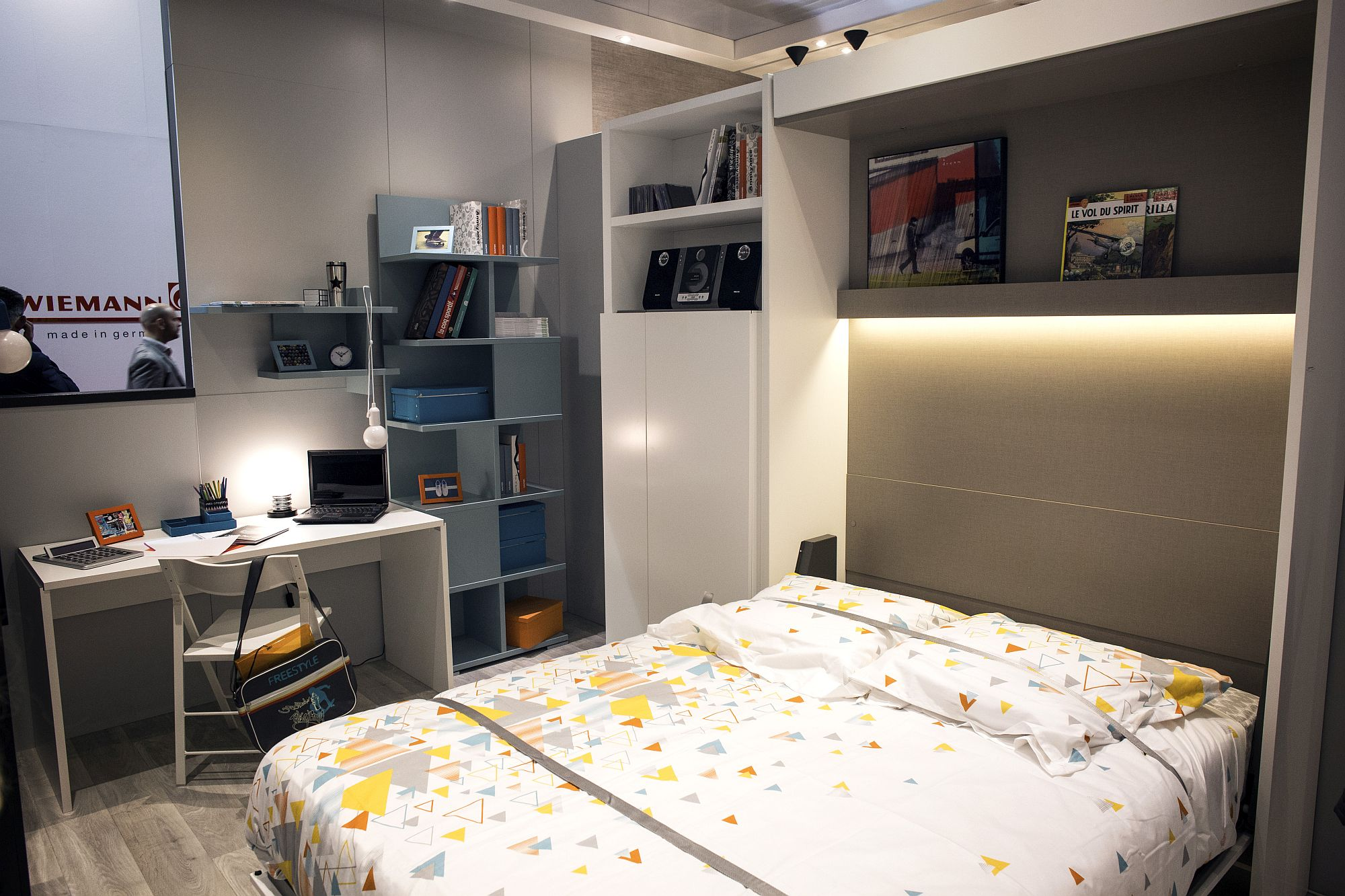 Open shelves and closed cabinets in the bedroom combined with smart lighting