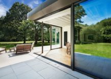 Open-white-deck-of-the-house-extends-the-living-area-into-the-garden-217x155