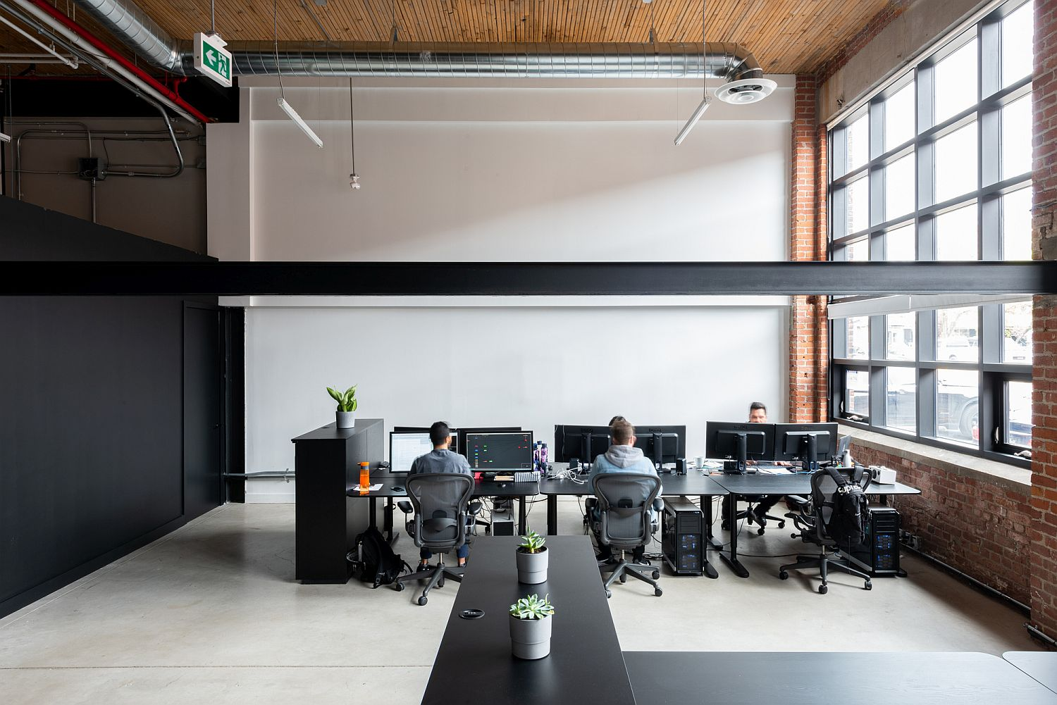 Open work areas of the office with gorgeous modern industrial style