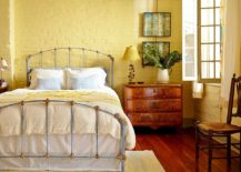 Painting-the-brick-wall-yellow-gives-the-bedroom-a-different-look-217x155