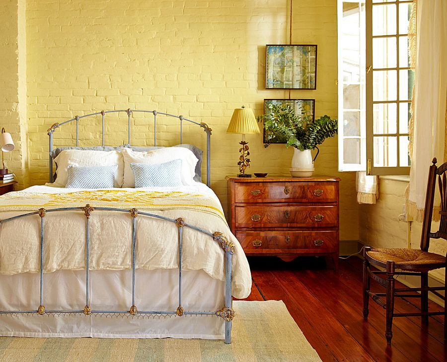 Painting the brick wall yellow gives the bedroom a different look!