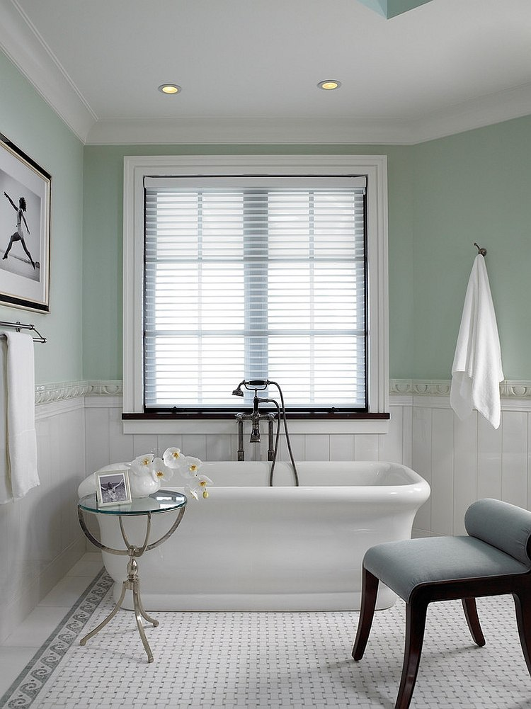 Pastel green and white make a cool combination in the exquisite bathroom
