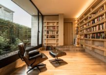 Reading-room-of-the-house-with-comfy-Eames-Lounger-and-woodsy-interior-217x155