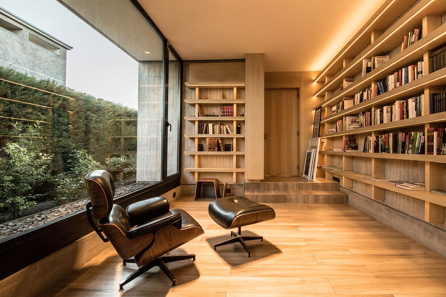 Reading room of the house with comfy Eames Lounger and woodsy interior
