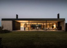 Rear-facade-of-the-home-opens-up-towards-the-outdoors-217x155