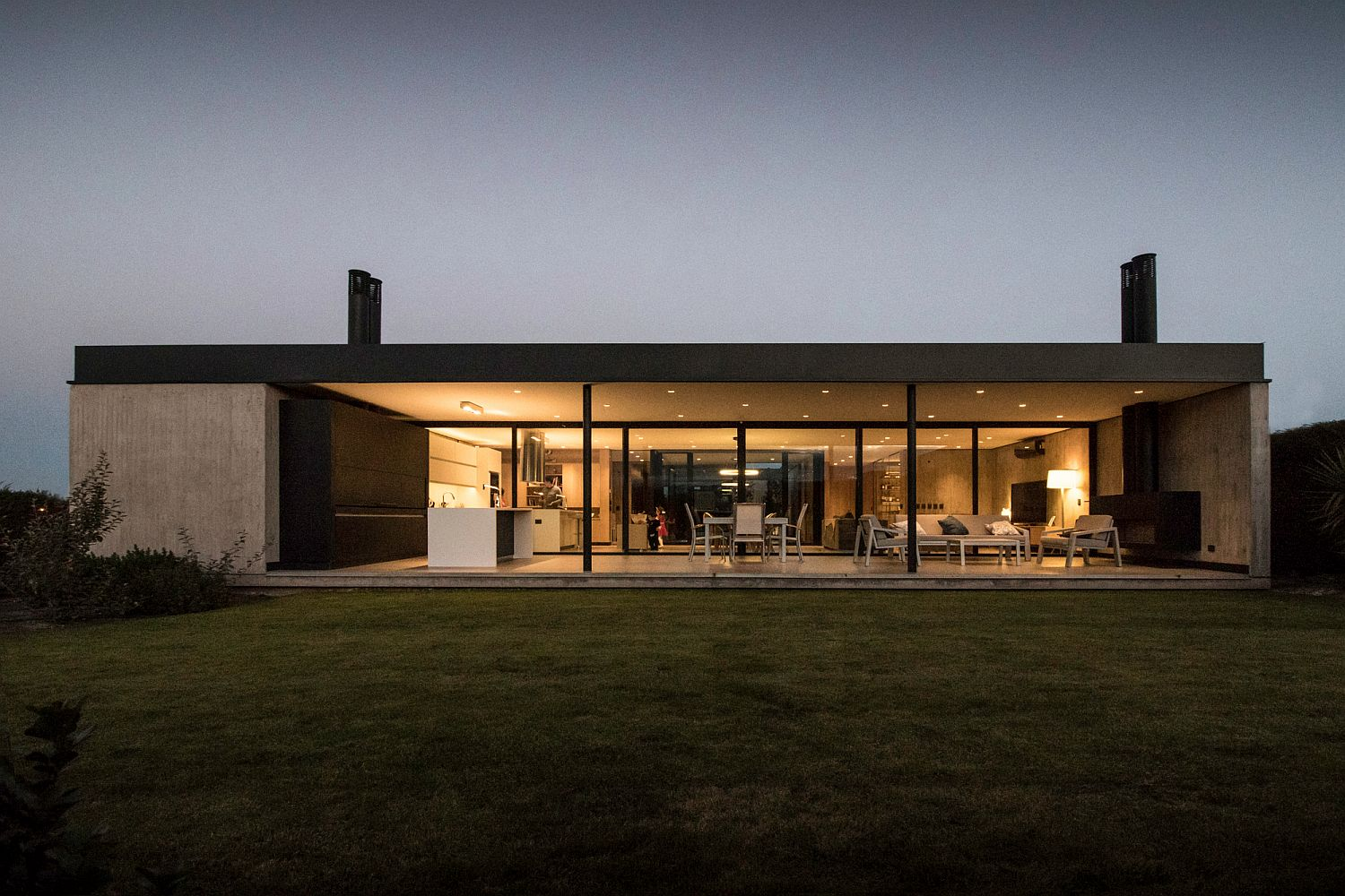Rear facade of the home opens up towards the outdoors