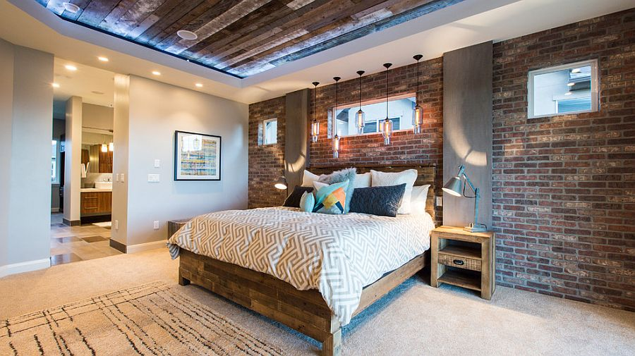 Reclaimed wood ceiling brings even more textural charm to the brick walled bedroom