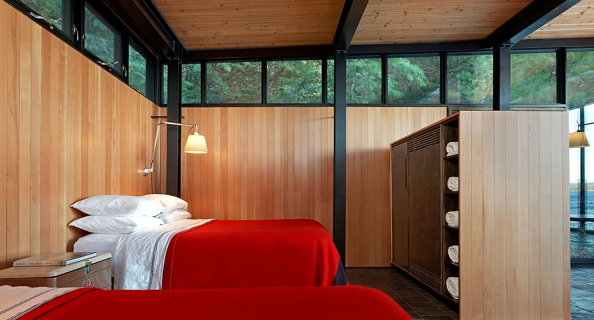 Relaxing and minimal bedroom of the Boat house with bedding in red