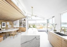 Remodeled-kitchen-and-dining-room-of-the-midcentury-home-in-wood-and-white-217x155