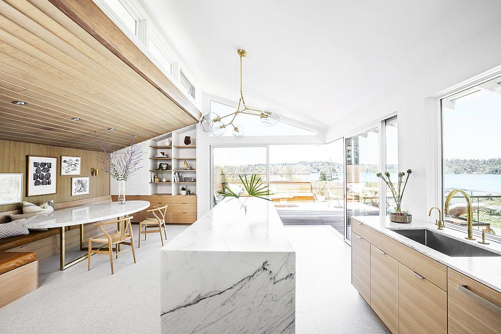 Remodeled-kitchen-and-dining-room-of-the-midcentury-home-in-wood-and-white