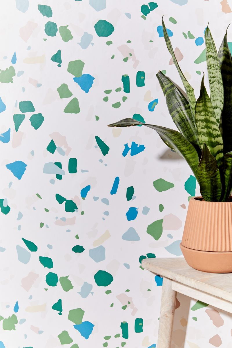 Removable terrazzo wallpaper in blues and greens