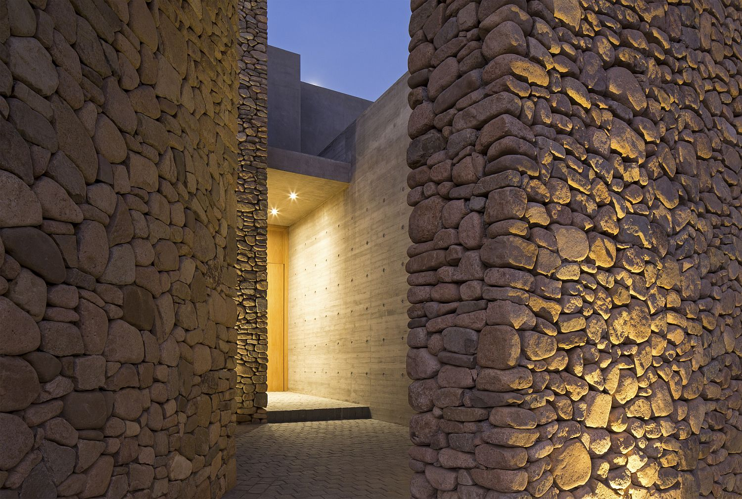 Sheltered entryway of the house in Chile made of stone