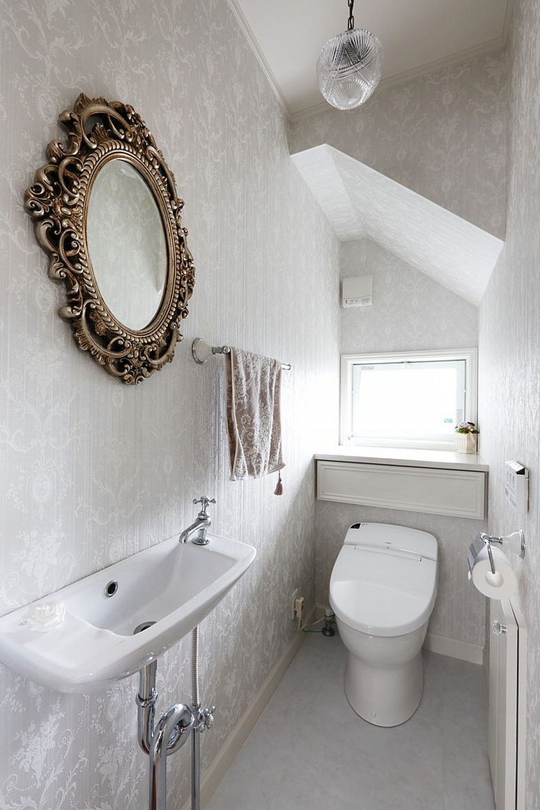 Silvery wallpaper gives the powder room a light and airy appeal