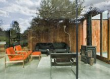 Small-and-simple-living-area-with-glass-walls-and-comfy-decor-217x155