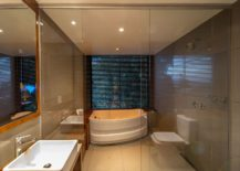 Small-bathroom-of-the-cabin-with-bathtub-and-shower-area-217x155