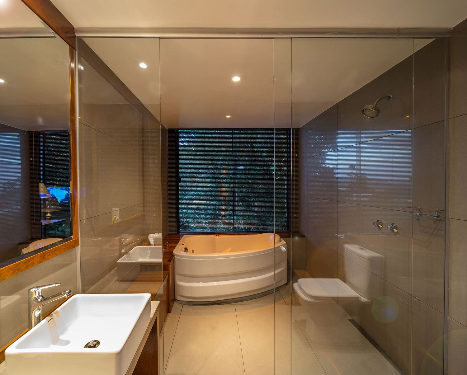 Small bathroom of the cabin with bathtub and shower area
