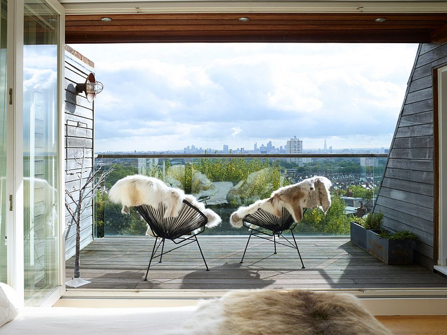 Small-farmhouse-style-balcony-with-a-couple-of-chairs-offers-simplicity-with-style