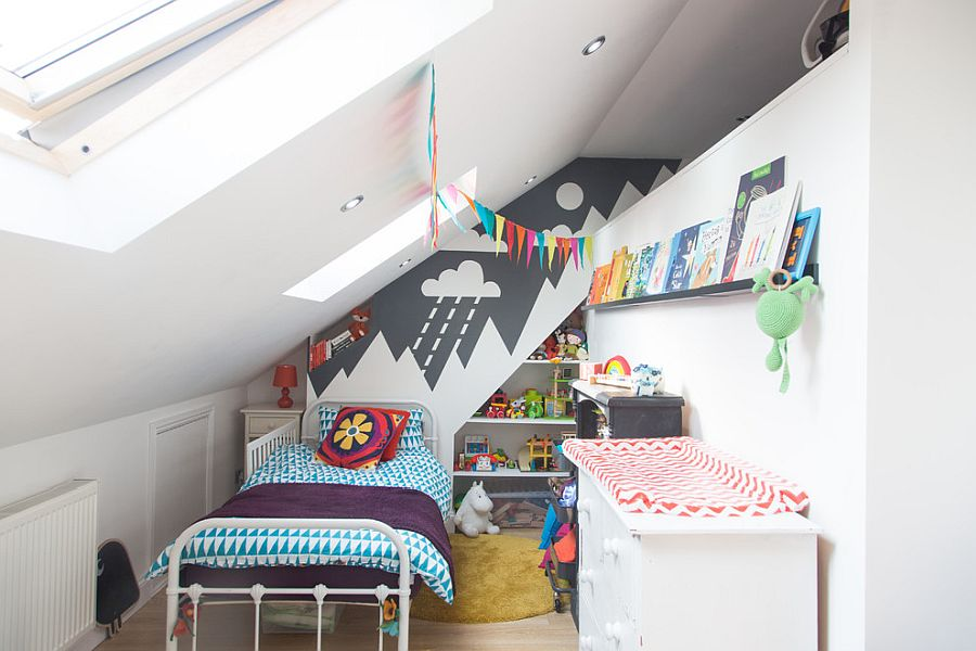 Small kids' bedroom with walls in white, angular ceiling and ample natural light