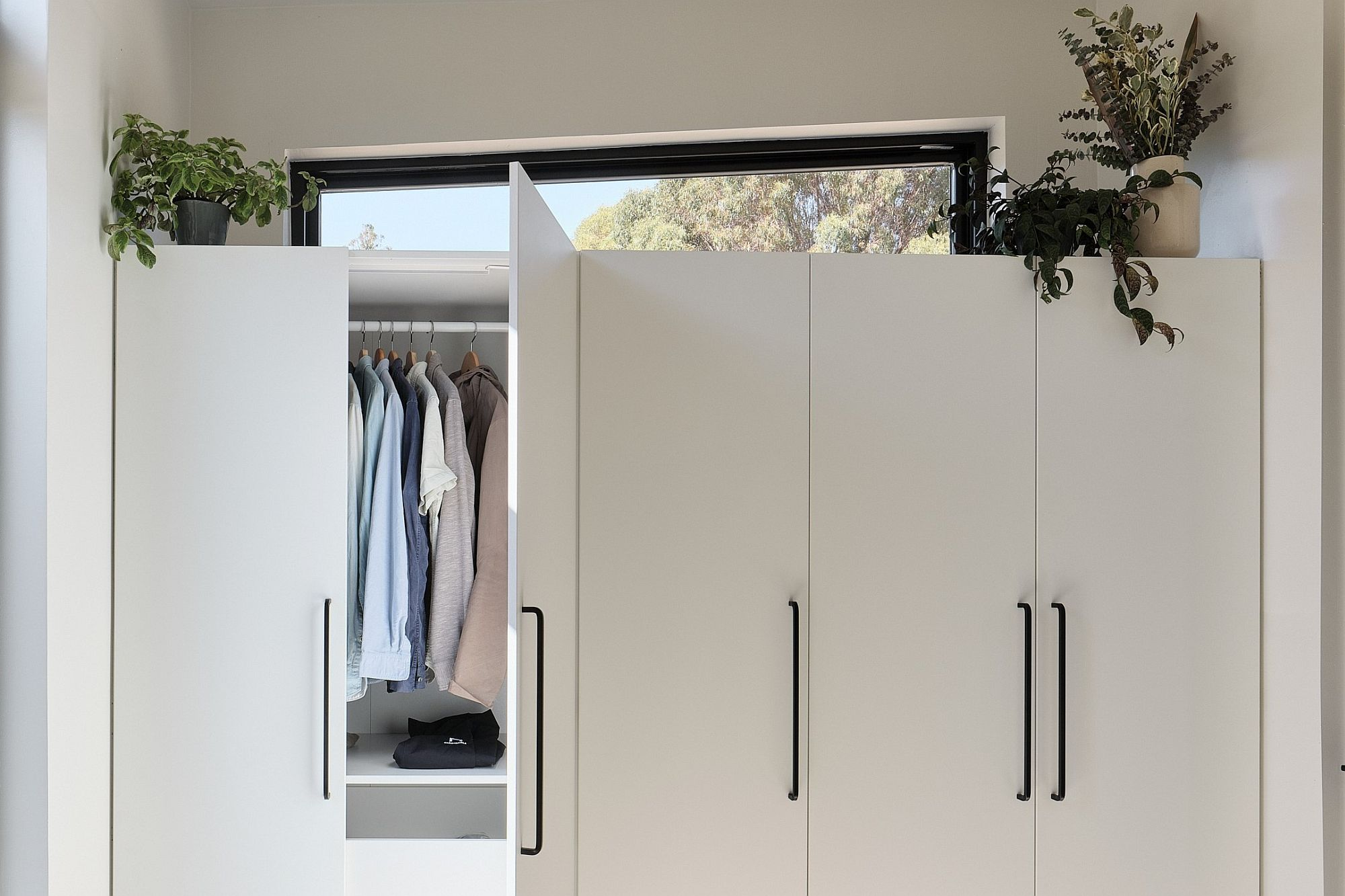 Smart and space-savvy bedroom wardrobe makes most of available space