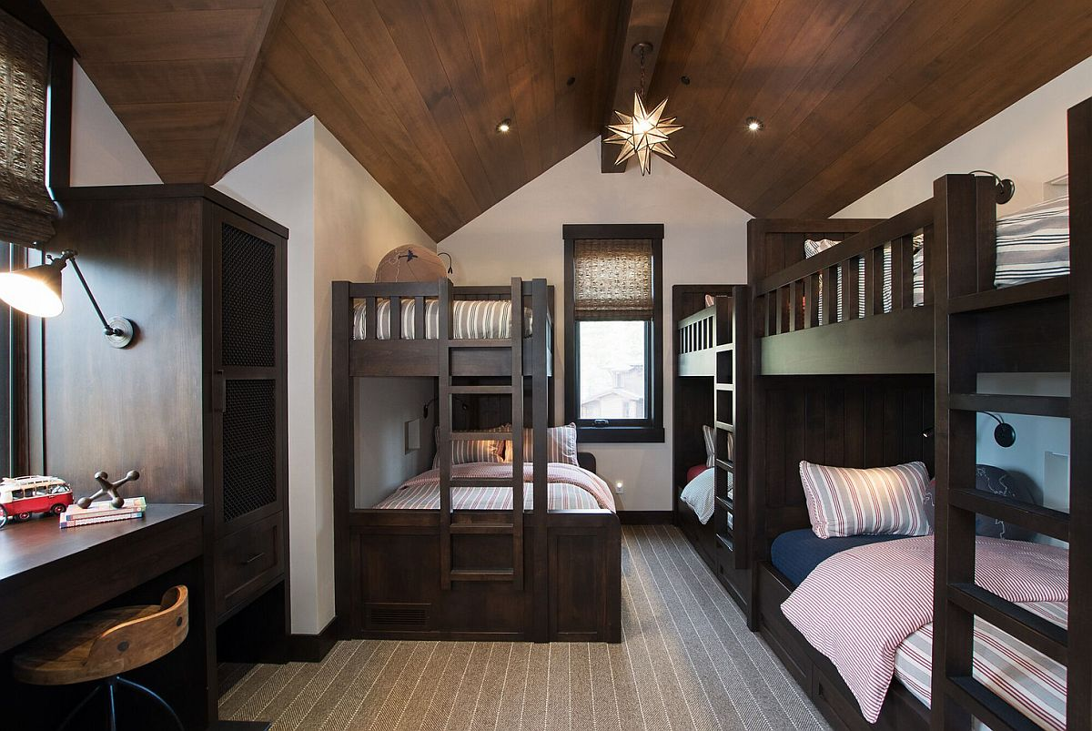 Spacious kids' room with vaulted ceiling and multiple bunk beds