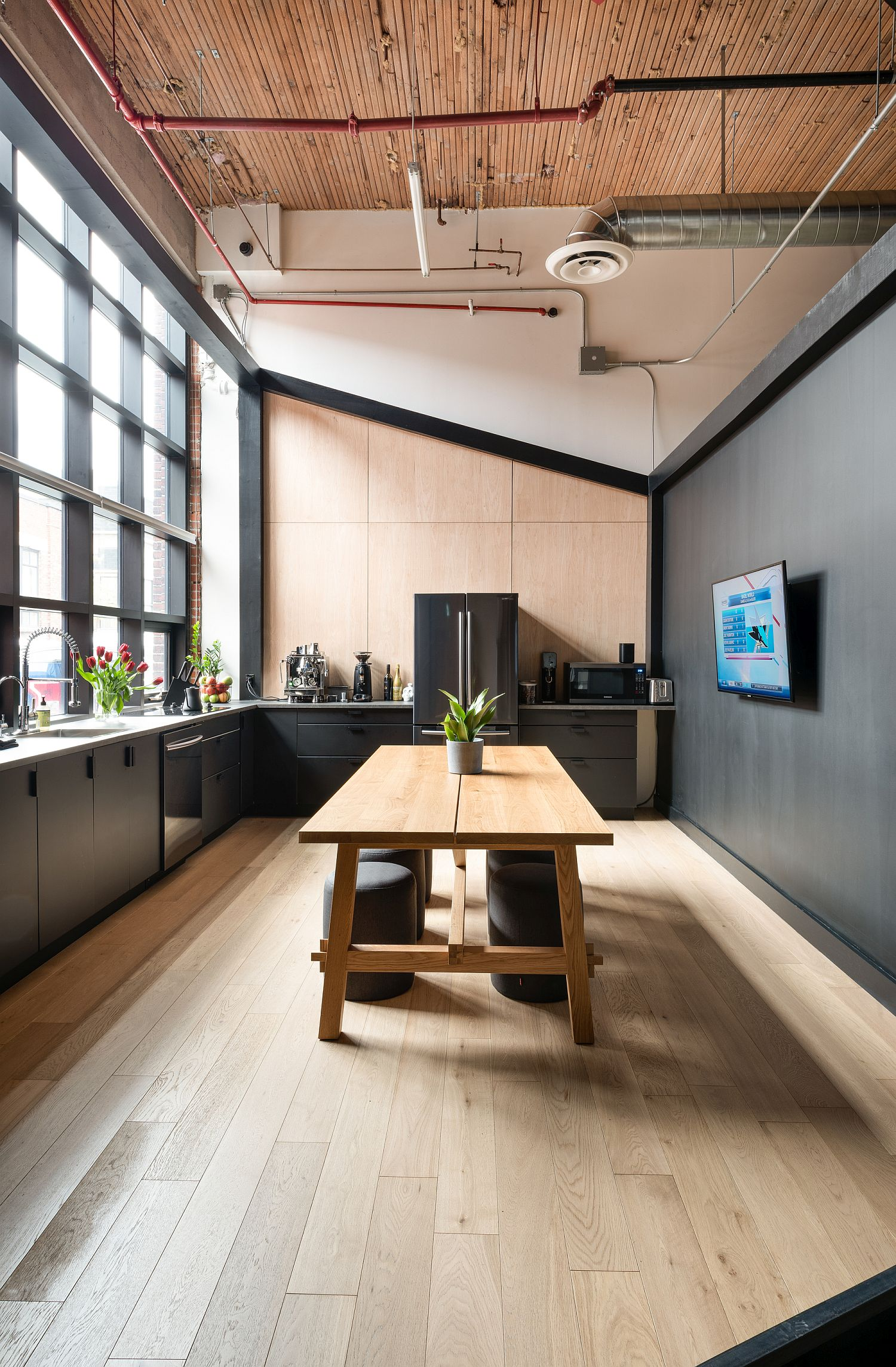 Spacious kitchen of the office with dark and dashing style