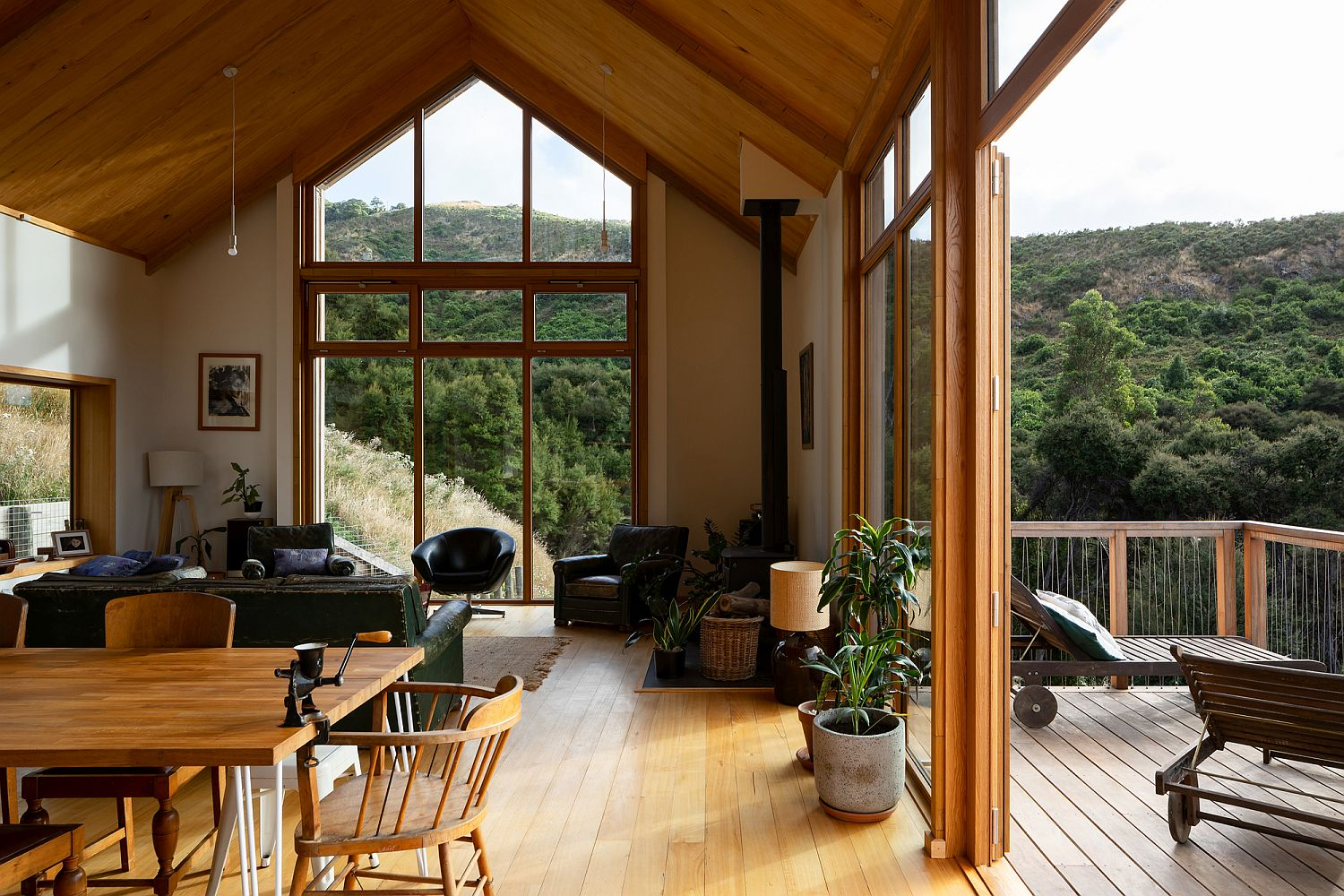 Spacious living area of the house in wood connected with the outdoors