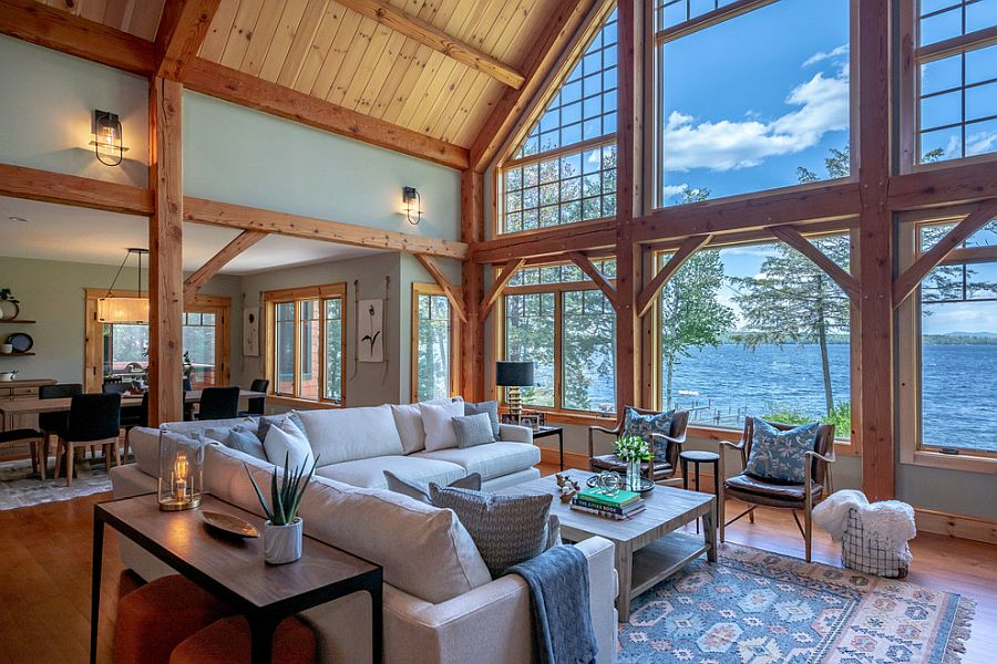 Spacious living room of the lake house with a gorgeous view and modern rustic style