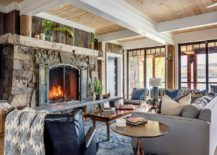 Stone-fireplace-coupled-with-accent-wooden-feature-in-the-small-rustic-living-room-217x155