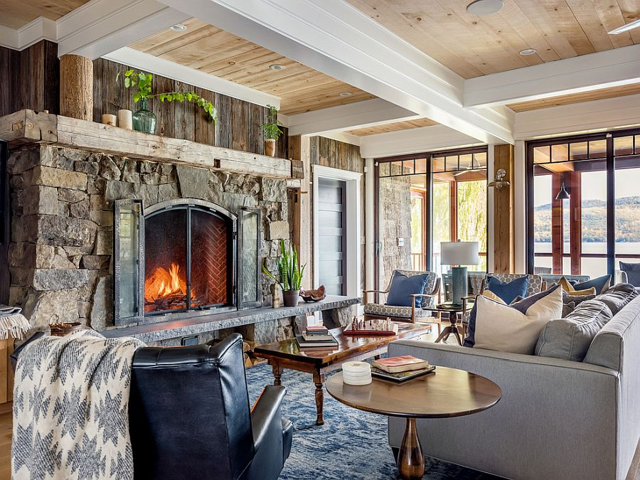 Stone fireplace coupled with accent wooden feature in the small rustic living room