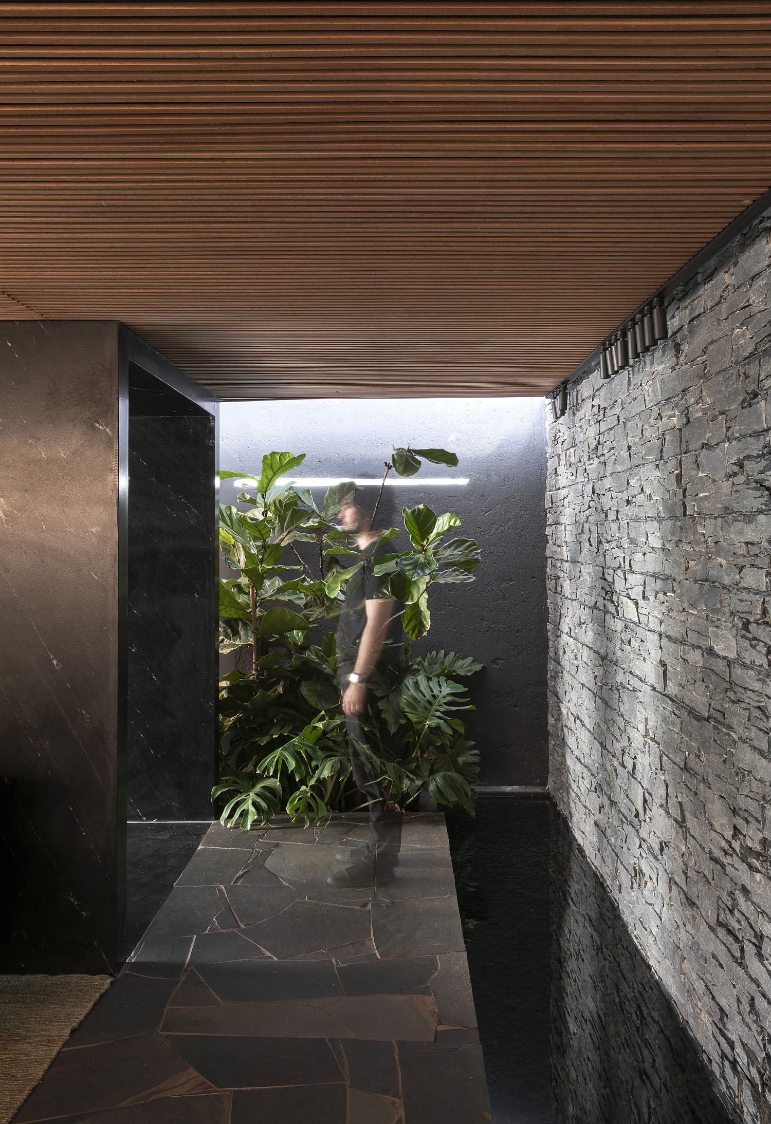 Stone-tunnel-and-water-feature-at-the-entrance-of-the-house