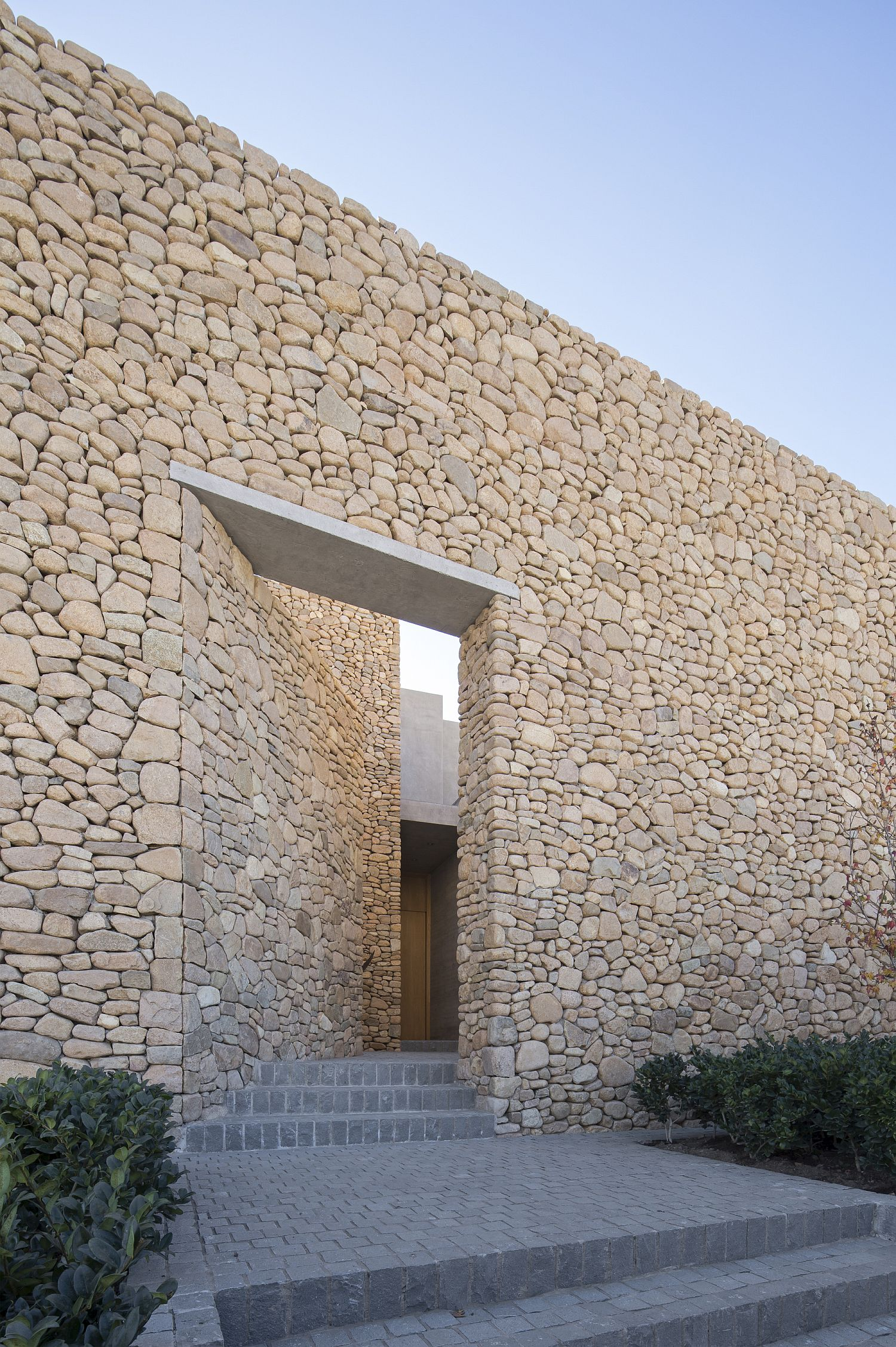 Stone walls around the house offer plenty of privacy along with unique textural charm