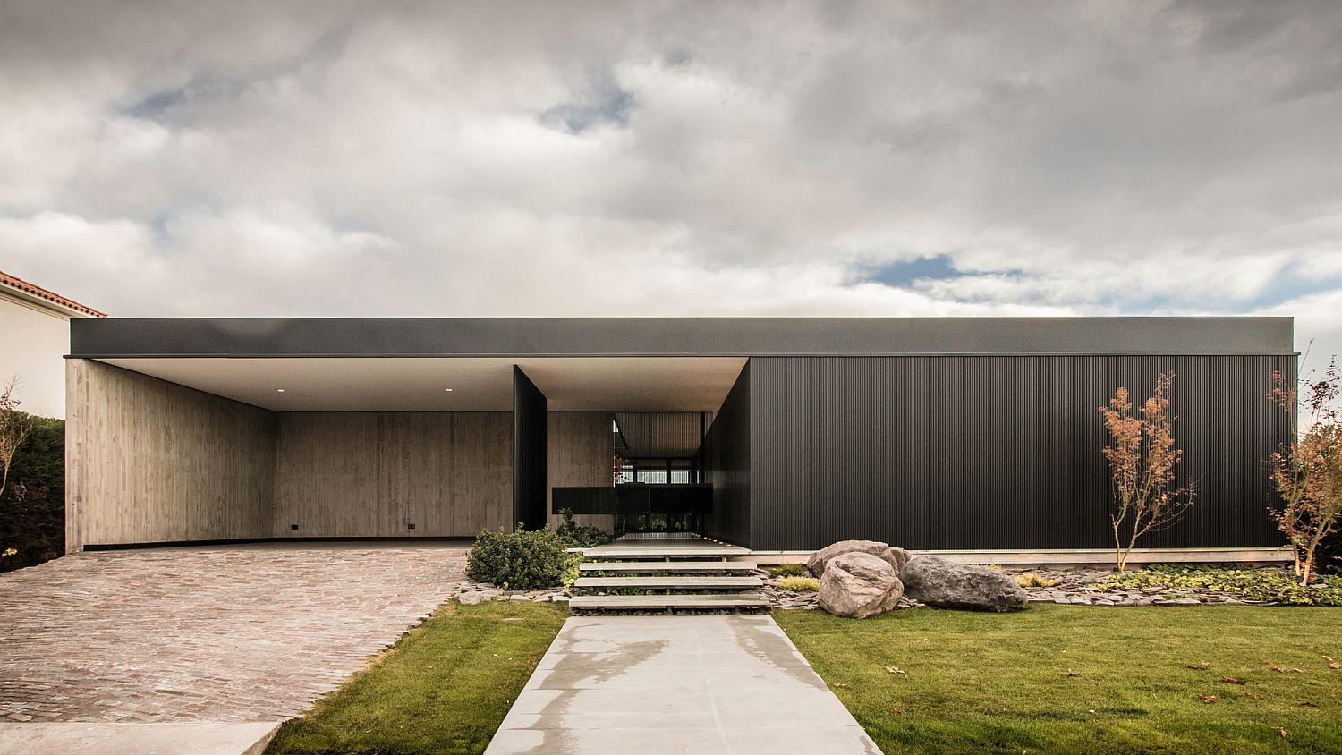Street facade of the house combines privacy with modernity