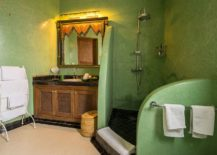 Textured-walls-in-green-for-the-spacious-Mediterranean-bathroom-217x155