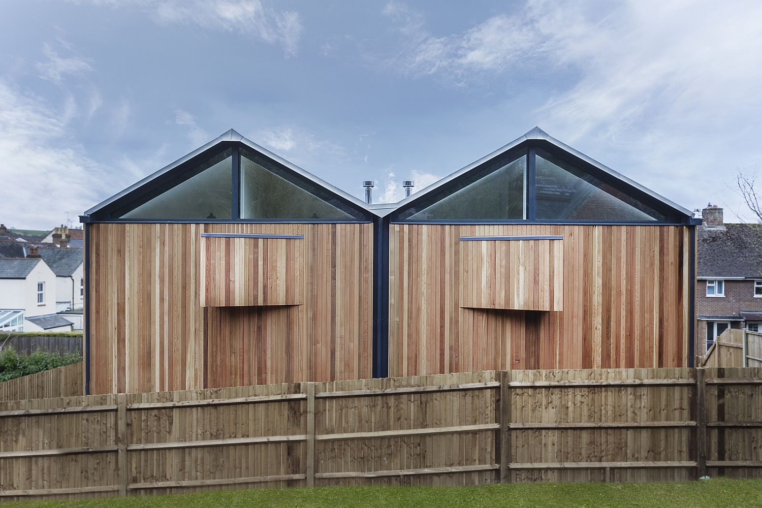 The Cedar Lodges in WInchester, UK with gabled roofs and wood exterior