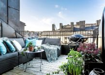 This-Stockholm-balcony-has-it-all-with-plush-seating-grill-and-a-bit-of-greenery-217x155