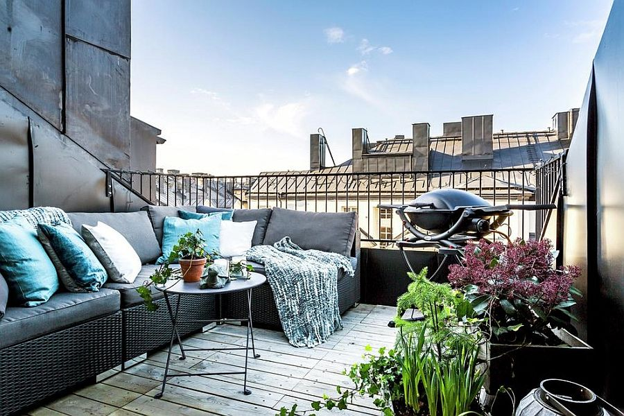 This-Stockholm-balcony-has-it-all-with-plush-seating-grill-and-a-bit-of-greenery