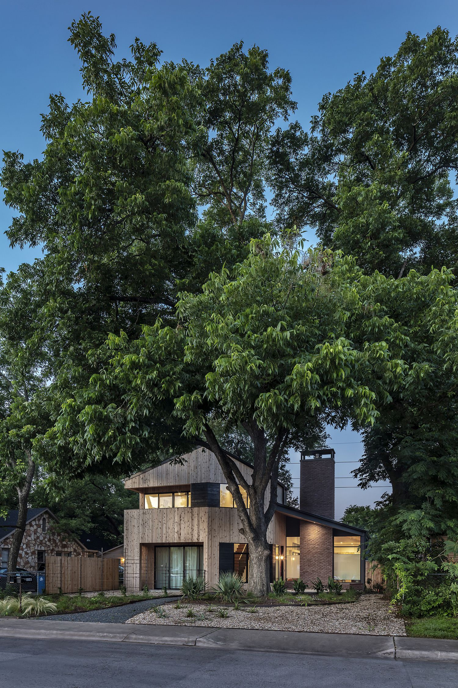 Trees around the house shapeits facade and overall appeal