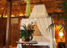 Using-the-sheer-to-decorate-the-four-poster-bed-and-turn-it-into-a-canopy-bed-217x155