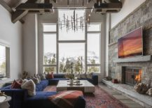 Vaulted-ceiling-brilliant-chandelier-and-wooden-accent-wall-shape-this-spacious-living-room-217x155