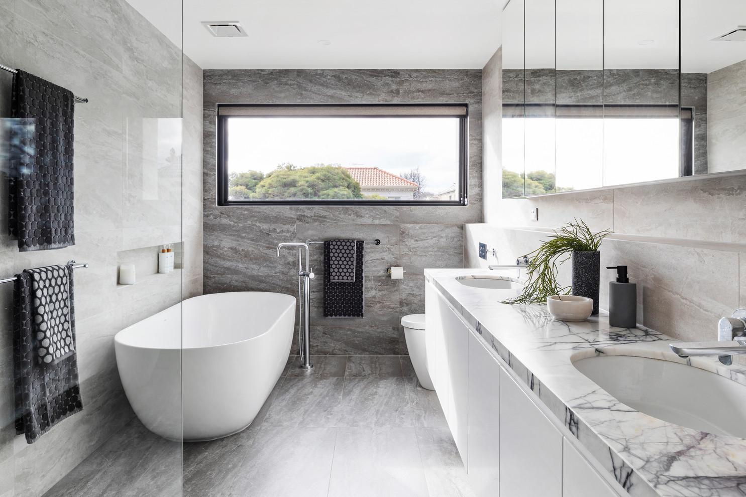 White and stone bathroom looks just splendid!