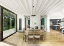 White-and-wood-dining-area-of-the-house-with-sliding-glass-doors-connecting-it-to-the-deck-outside-217x155