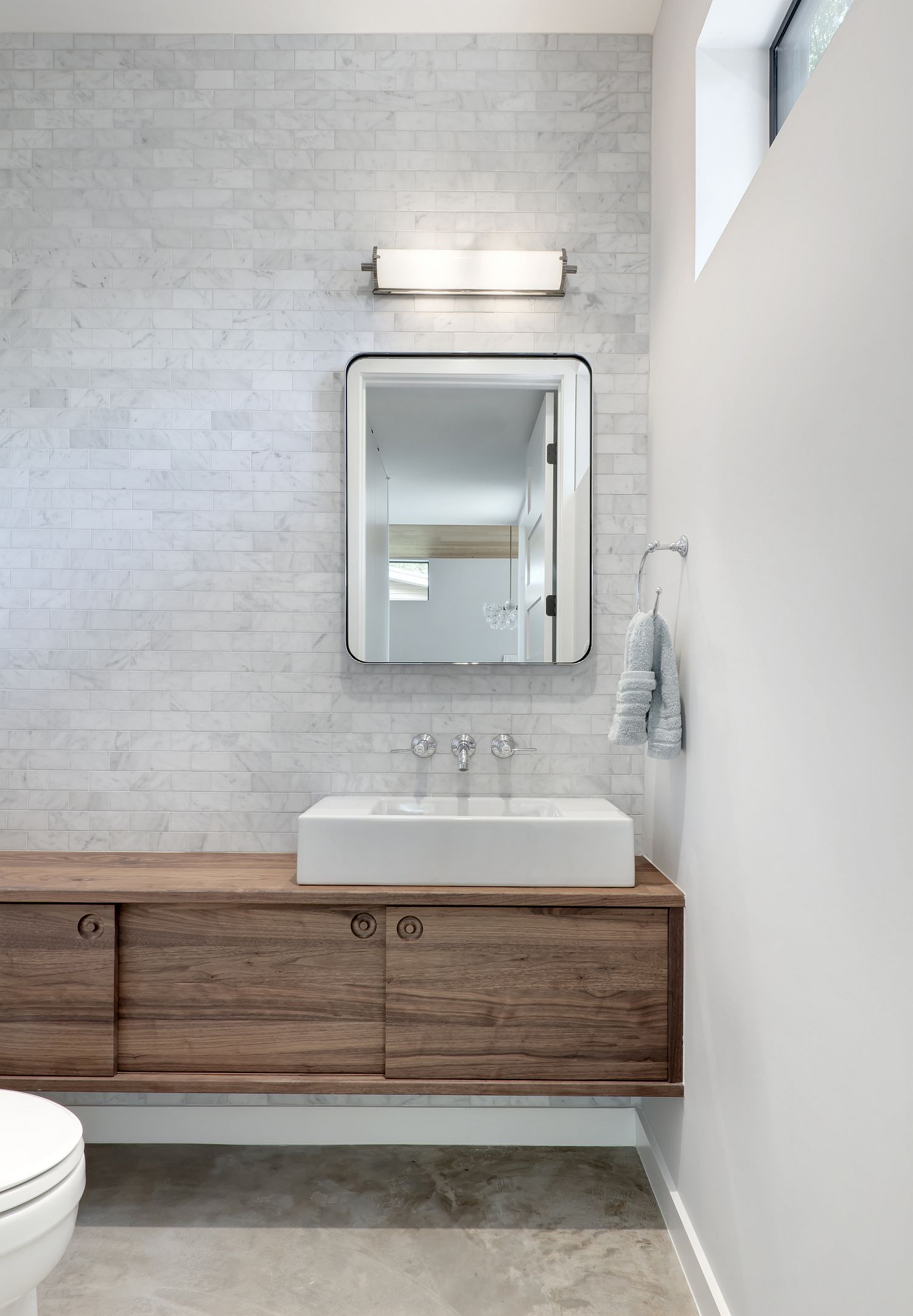 White modern bathroom with contemporary style and a floating wood vanity