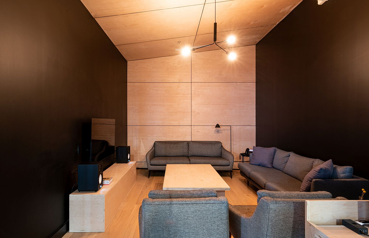 Wood and black spaces make a cool statement inside the office