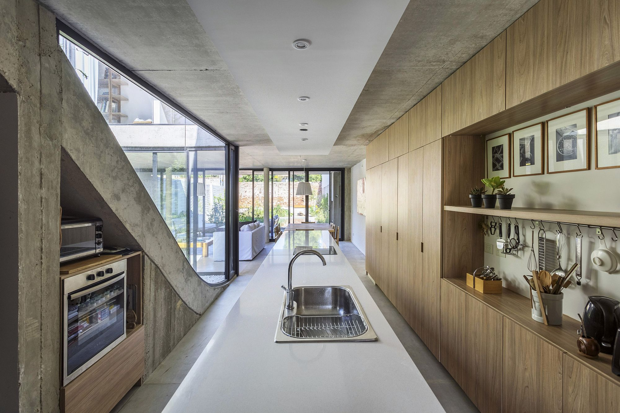 Wood and concrete kitchen and dining area of the MeMo House