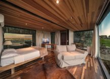 Wood-and-glass-bedroom-of-the-cabin-with-wonderful-view-of-the-landscape-around-it-217x155