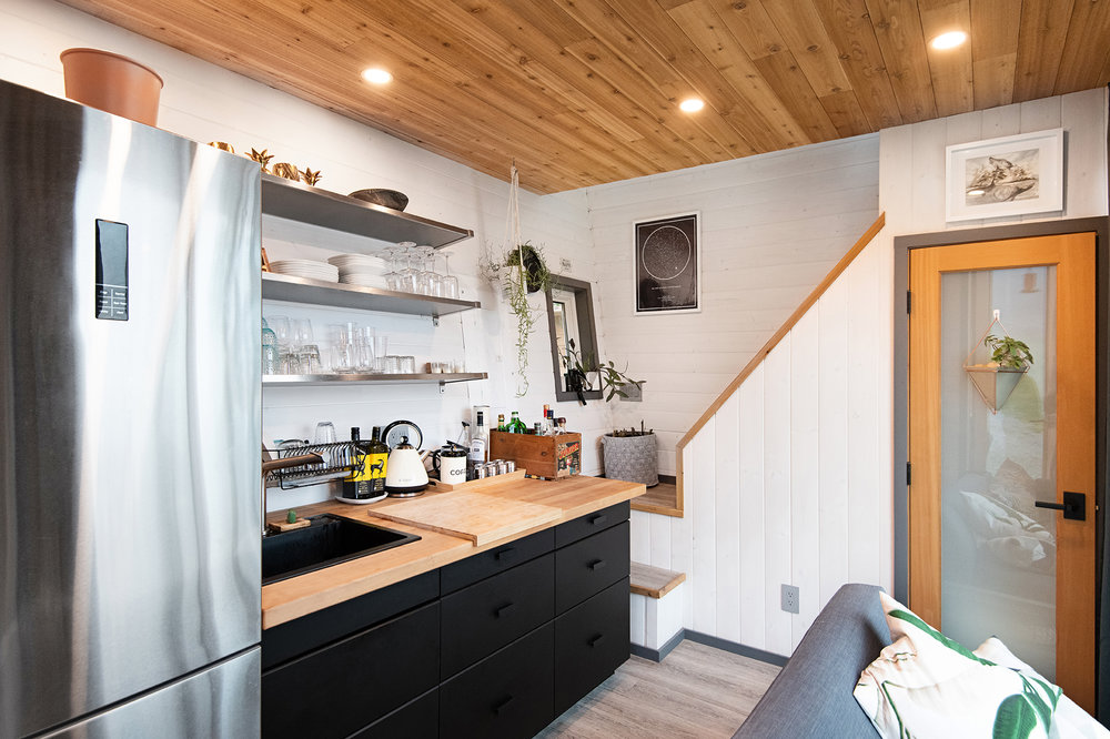 Wood and white kitchen with dark workstation is both practical and smart