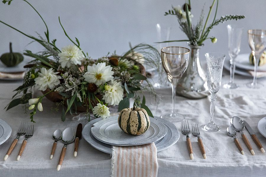 Add a bit of greenery to the white and wood fall-themed table
