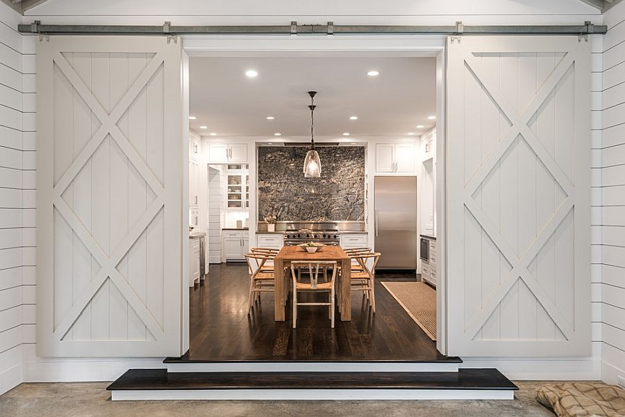 Barn style sliding doors for the kitchen with dining area inside