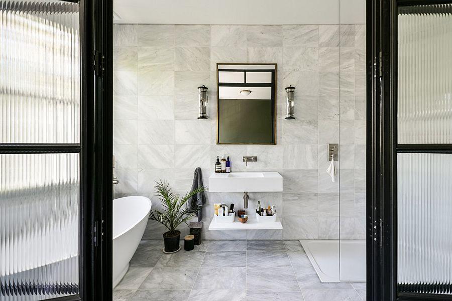 Black frame for the sliding glass doors of the white bathroom