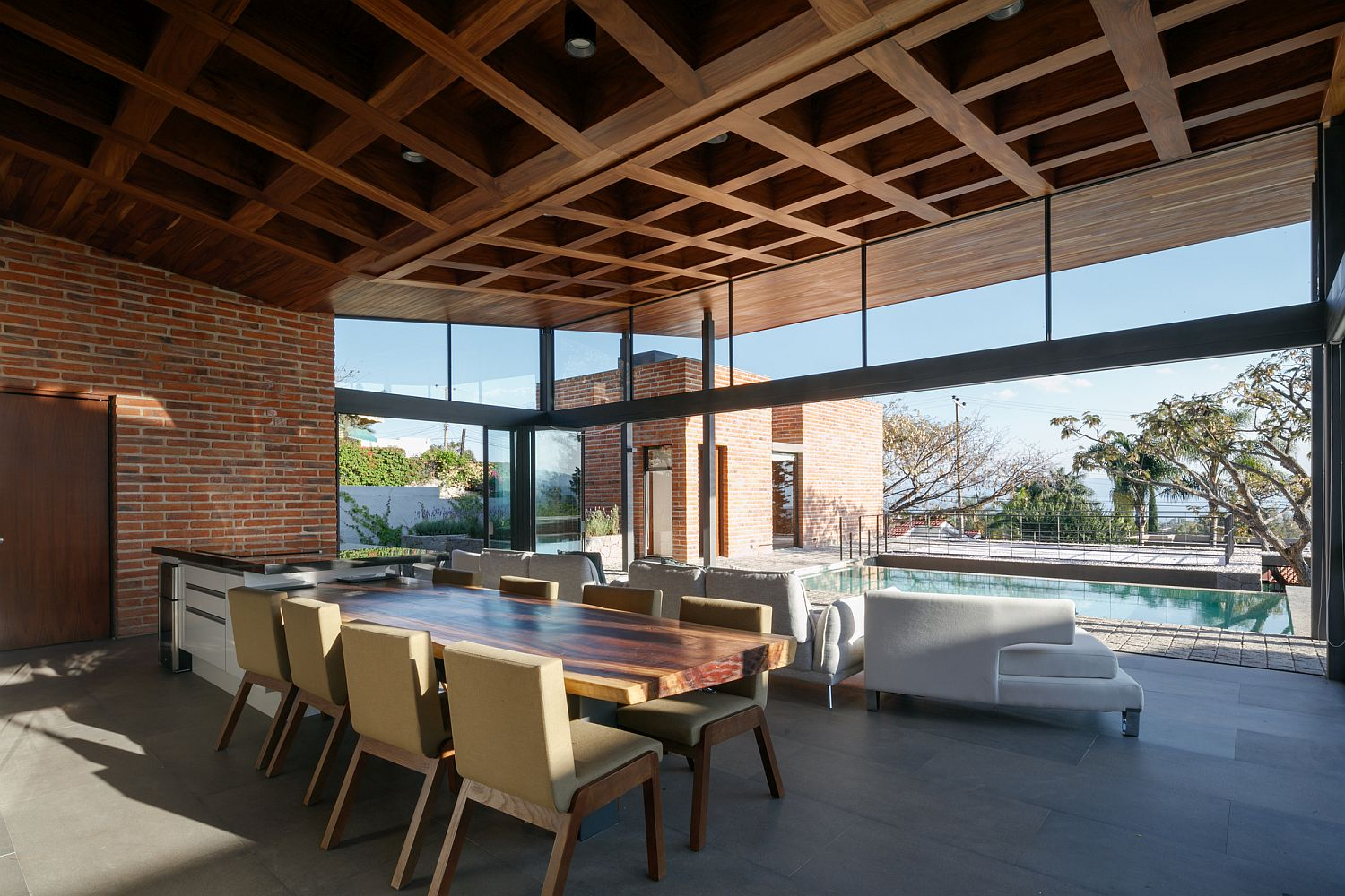 Coffered wooden ceiling of the house coupled with brick walls